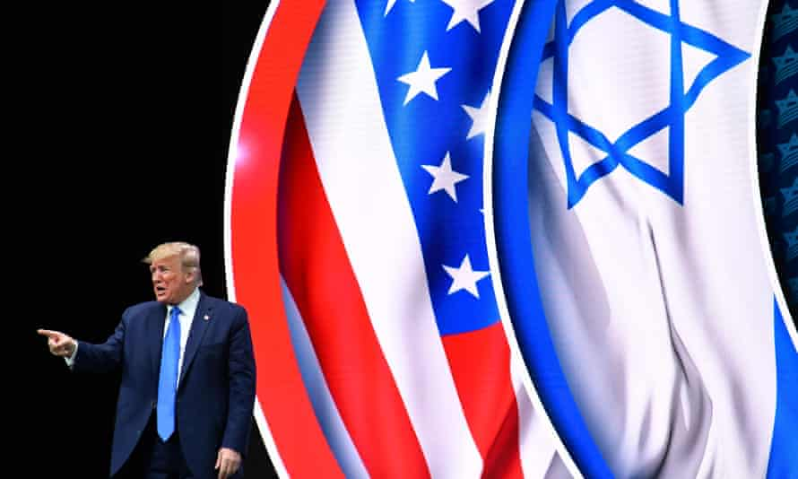 Donald Trump stands on stage after his address to the Israeli American Council national summit on 7 December.