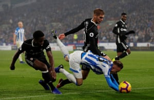Huddersfield Town's Florent Hadergjonaj goes down after a challenge from Ryan Sessegnon.