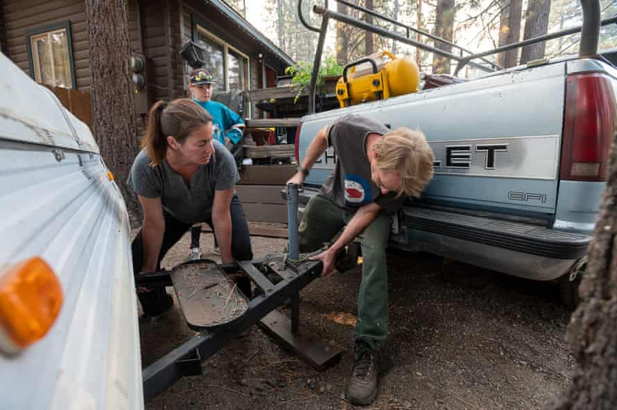 Jess Anderson and ex-wife Corinne Kobel pack up their home to evacuate South Lake Tahoe as their son Ethan, 11, watches.