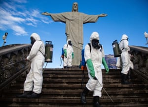 Soldiers of the Brazilian army disinfect the Cristo Redentor monument in Rio de Janeiro to reopen the tourist spot to the public on 15 August.