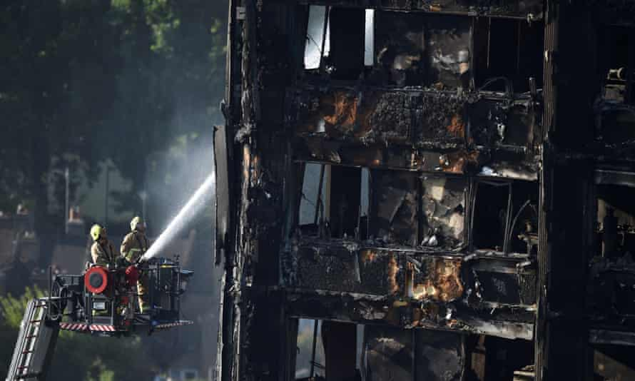 Firefighters spray water on Grenfell Tower two days after the fire in west London killed 72 people