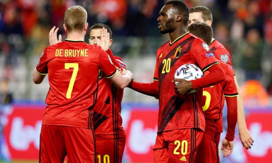 Belgium's Christian Benteke celebrates scoring their first goal with teammates