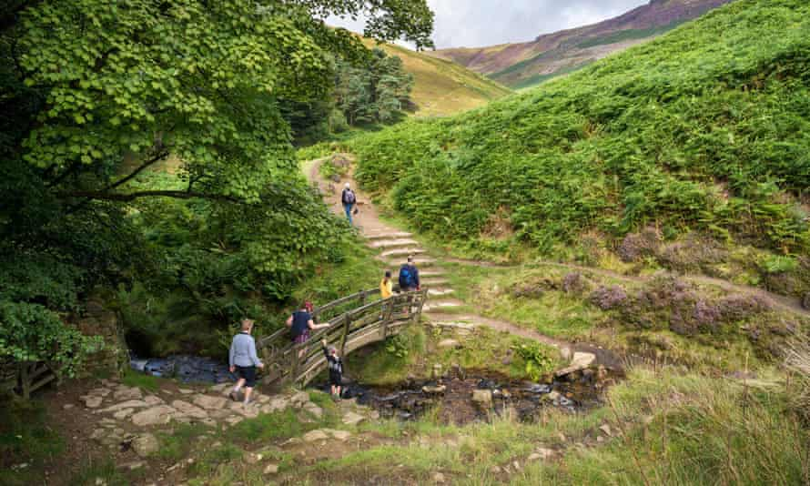 A family group walking in Edale, Derbyshire, in the Peak District national park