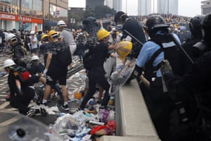 Police use pepper spray on demonstrators.