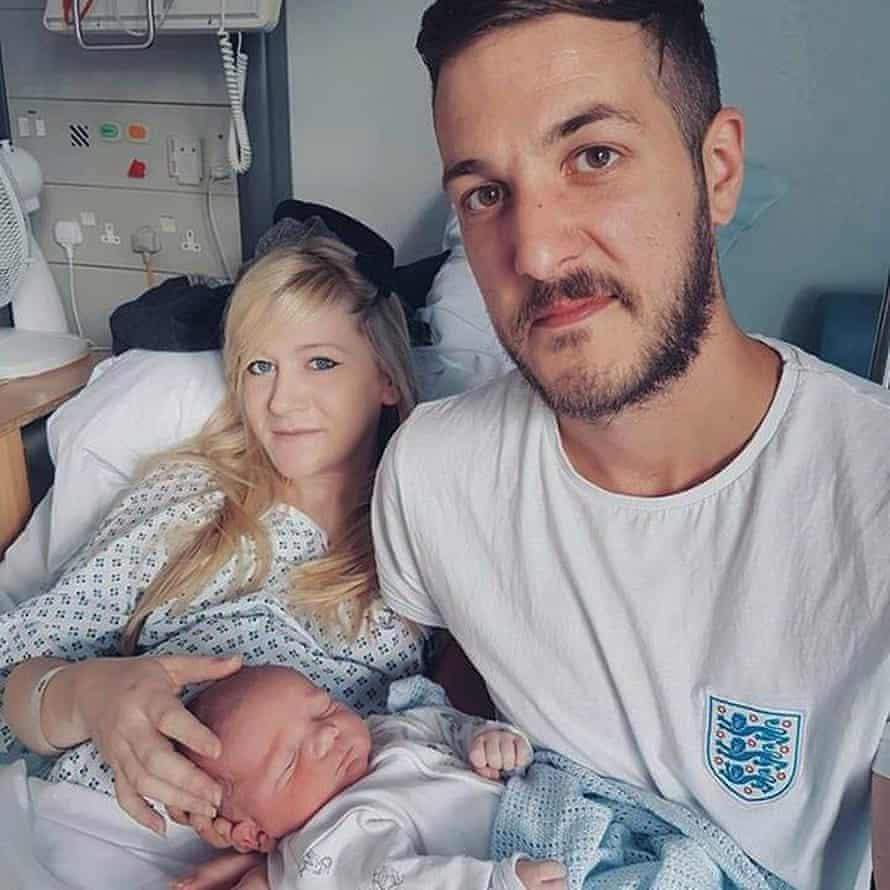 Charlie with his parents shortly after he was born.