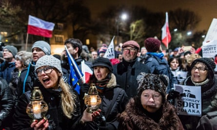 Anti-government protesters outside the Warsaw home of Jarosław Kaczyński, leader of Poland's ruling Law and Justice (PiS) party in December.