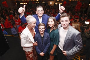 Daniel Andrews poses for a photo with his family.