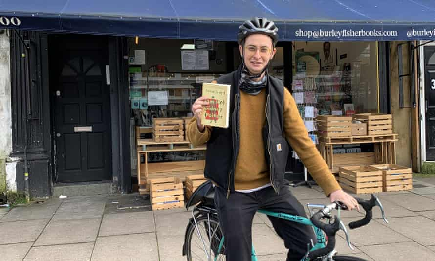 Sam Fisher, co-owner of Burley Fisher Books in Haggerston, London, is delivering books during the coronavirus outbreak.