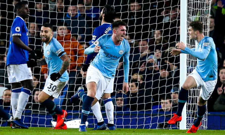 Aymeric Laporte (centre) celebrates after his header puts Manchester City in front against Everton.