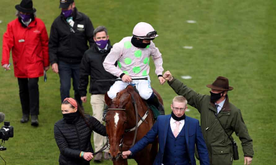 Willie Mullins (bottom right) celebrates Cheltenham victory with Paul Townend on Monkfish.