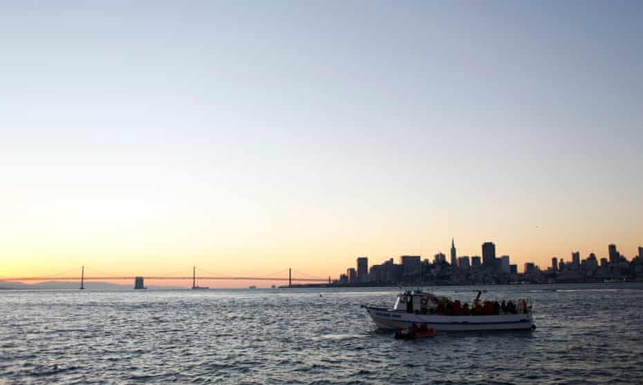 Swimmers with the South End Rowing Club prepare to jump into San Francisco Bay near Alcatraz Island during the annual New Year's Day swim to Aquatic Park in San Francisco, California, US.