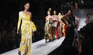 Model Joan Smalls in a yellow Moschino gown.