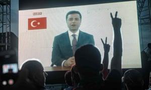 Supporters watch Selahattin Demirtaş's televised address.