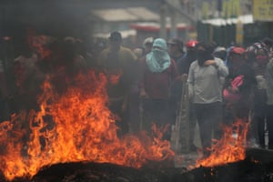 Calderon, Ecuador People set a barricade on fire as they block a road during protests after President Lenin Moreno's government ended four-decade-old fuel subsidies