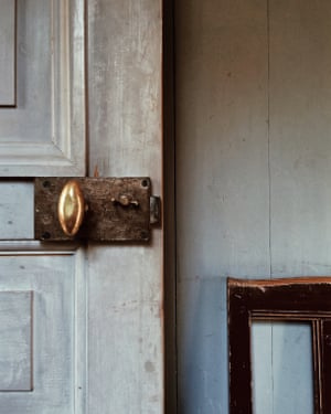 Close up image of a door handle and white door at Gunnebo House, south of Gothenburg, Sweden