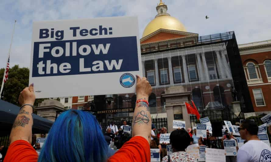 A demonstration against gig economy companies' ballot initiative in Boston in June.