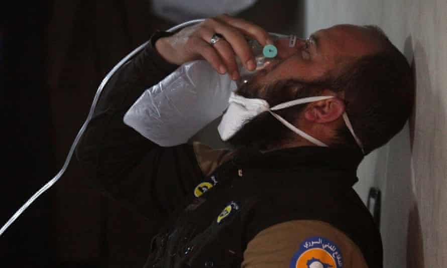 A civil defence member breathes through an oxygen mask, after the suspected gas attack in Khan Sheikhun.