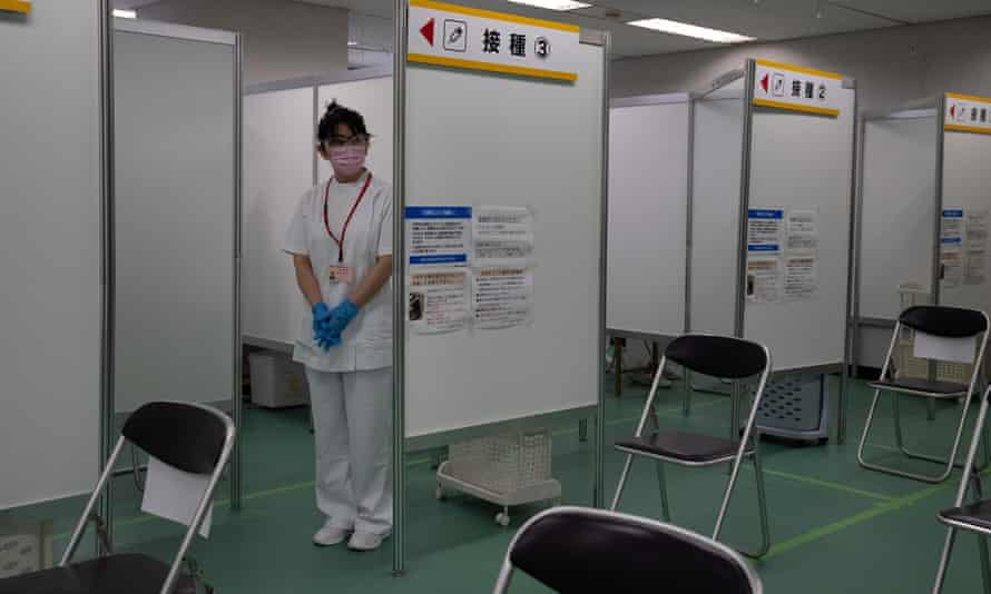 A nurse waits to inoculate people with the Moderna coronavirus vaccine at the newly-opened mass vaccination centre on May 24, 2021 in Tokyo, Japan.