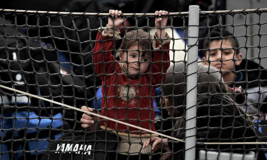 A child among the migrants and refugees arriving at Lesbos after crossing the Aegean Sea from Turkey.