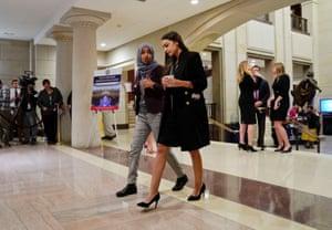 Alexadria Ocasio-Cortez,IIhan OmarRep.-elect Alexandria Ocasio-Cortez, D-NY., right, walks and talks with Rep.-elect IIhan Omar, D-Minn., left, prior to a member-elect briefing on Capitol Hill in Washington.