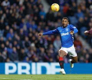 Jermain Defoe of Rangers waits for the ball to drop before shooting to score and give Rangers a 1-0 lead.