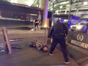 A picture that has been circulating showing a man on the ground; he appears to have canisters strapped to his body. The Guardian is not showing his face until his identity and connection to the incident has been established.