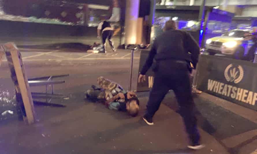 A picture that has been circulating showing a man on the ground who appears to have canisters strapped to his body. The Guardian is not showing his face until his identity and connection to the incident have been established.