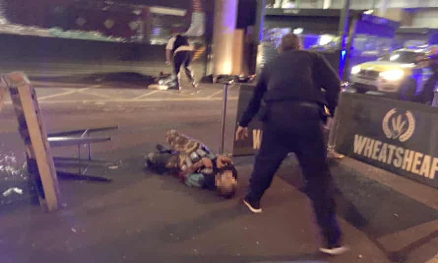 A picture that has been circulating showing a man on the ground, apparently with canisters strapped to his body.