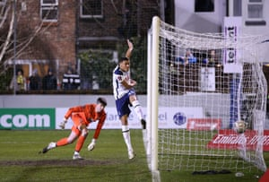 Carlos Vinicius of Tottenham Hotspur scores his team's first goal past Bayleigh Passant of Marine.