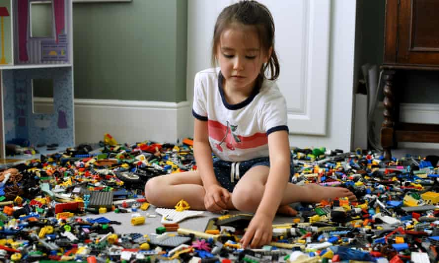 A child plays with Lego