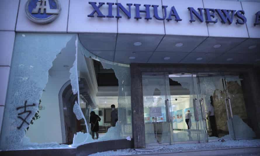 Broken windows at Xinhua's Hong Kong office