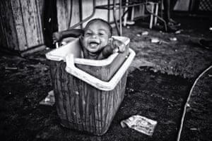 Sardie Sardie (2 yr) is cooling off in an esky as temperatures can reach to the 40°C. Sardie lives in Kennedy Hill and is one of the happiest and cutest babies I have ever seen. Totally unaware of the problems in the Community, Sardie is happy as Larry. Kennedy Hill, Broome, WA