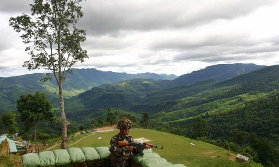 An Indian soldier stands guard at Henglep, about 60 miles south of Imphal, the capital of Manipur, a lush province in north-east India that borders Myanmar