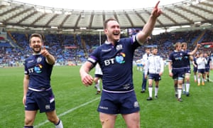 Stuart Hogg, right, and Greig Laidlaw celebrate Scotland's victory in Rome.