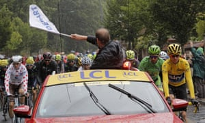 The Tour de France director, Christian Prudhomme, waves the 'Depart' flag.