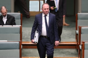 The deputy prime minister walks into the chamber