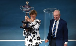 Margaret Court poses with the trophy presented to her by Rod Laver prior to the fourth-round match between Rafael Nadal and Nick Kyrgios at the Australian Open