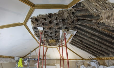 The plaster ceiling being stripped back to reveal the original.