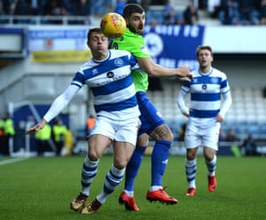 Callum Paterson of Cardiff City and Jake Bidwell of QPR compete for the ball.