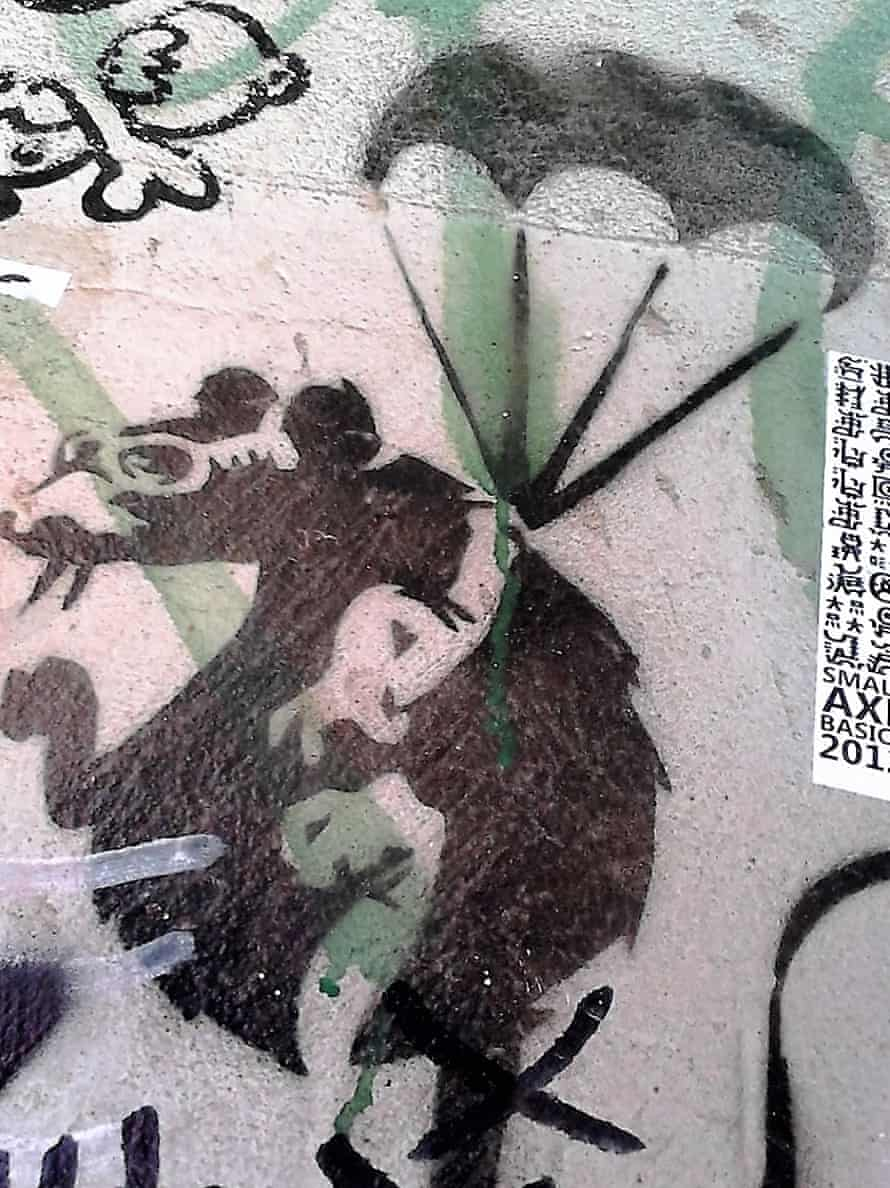 The Banksy stencil of a parachuting rat that used to b over a doorway in ACDC Lane