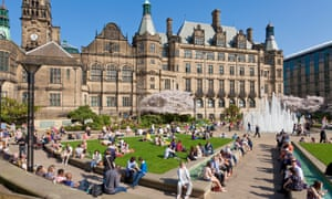 People enjoy sunshine at Sheffield town hall and Peace Gardens.
