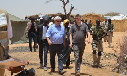 Stephen O'Brien, centre, UN under-secretary-general for humanitarian affairs and emergency relief. visits a refugee camp in the south-east of Niger.