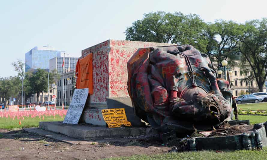 A headless statue of Queen Victoria is seen overturned at the provincial legislature in Winnipeg on Friday.