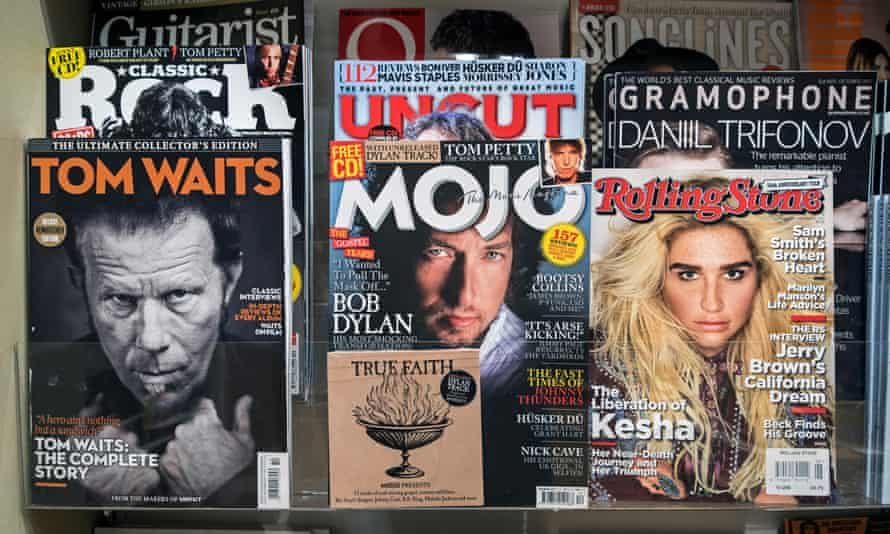 A 2020 issue of Mojo, complete with cover CD, in a newsagent.