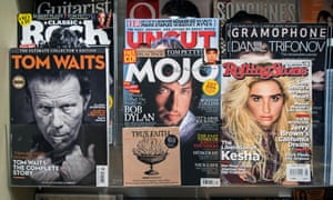 Rolling Stone magazine is seen on display with other music publications.