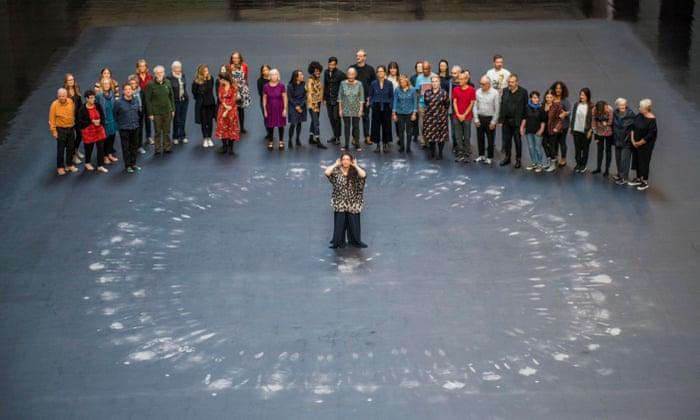 image of people surrounding tania burguera