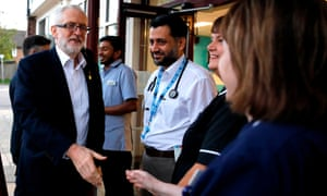 Jeremy Corbyn greets NHS staff as he arrives at Crawley hospital, London