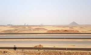 The southern highway cuts across desert within view of Red Pyramid in Giza.