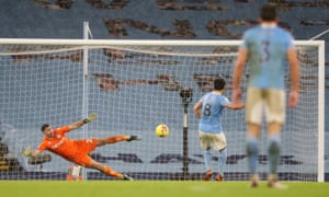 Manchester City's Ilkay Gundogan scores their second goal from the penalty spot.