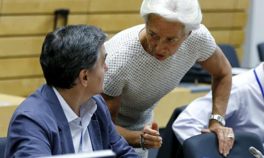 IMF chief Christine Lagarde talks to Greek finance minister Euclid Tsakalotos during the eurozone finance ministers' meeting in Brussels.
